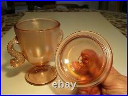 Old Fenton Pink Carnival Glass Twin Dolpin Fish Handled Covered Candy Jar Set
