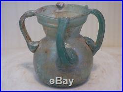 ROMAN GLASS JAR WITH 4 HANDLES. C. 4th century
