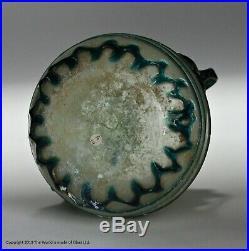 Small Roman pale blue twin-handled glass jar