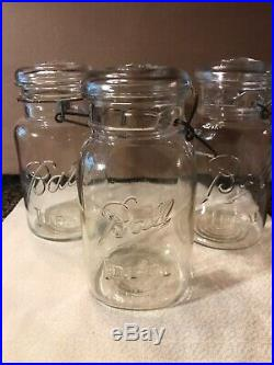 Three Vintage Quart Glass Jars With Lids And Handles