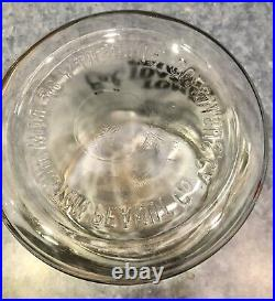 Vintage Eat Toms Toasted Peanuts $. 5 Glass Jar withLid & Toms Embossed Handle